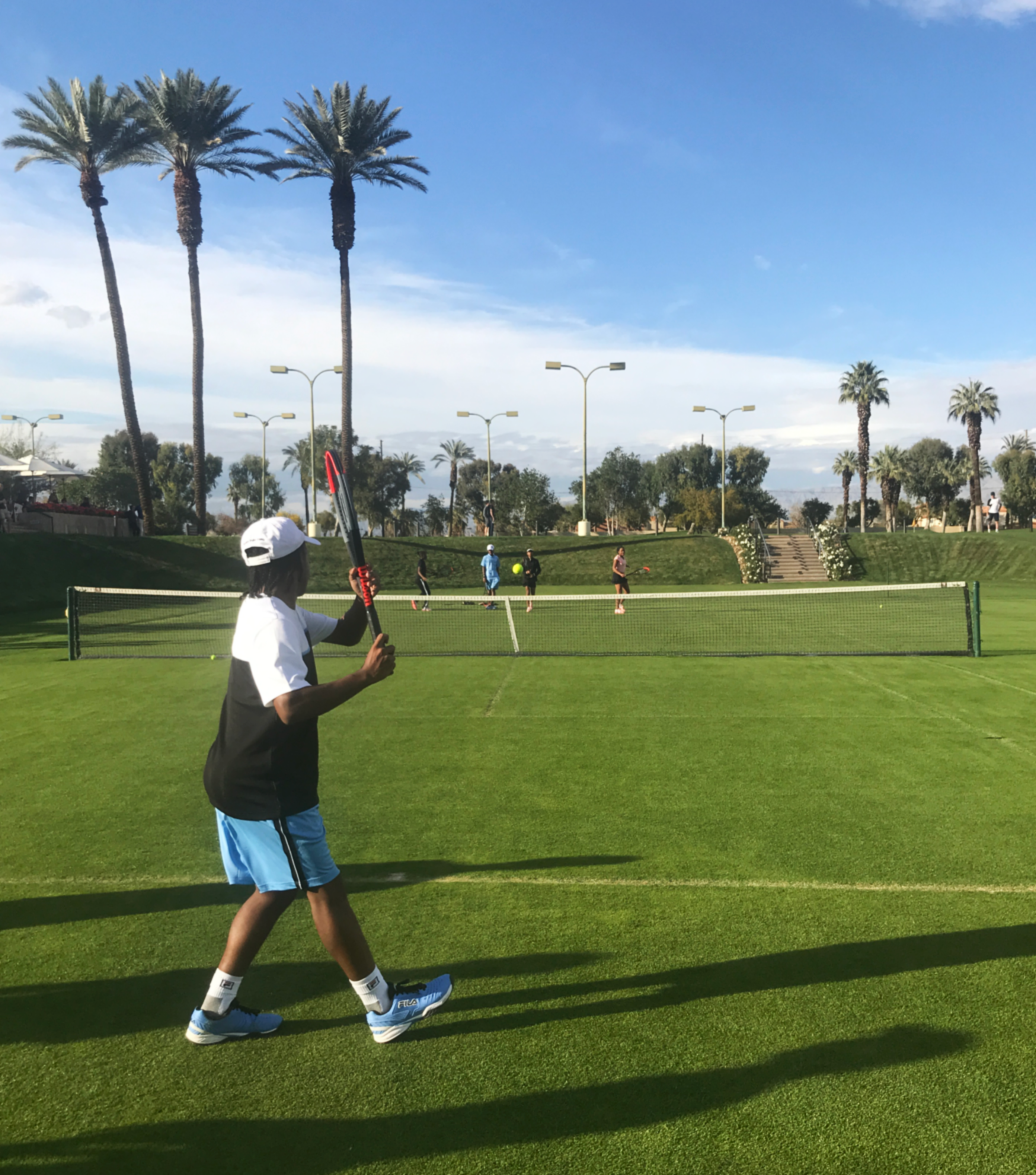 Finalist of the Tie Break Tens Challenger, Romero, tests out his new Wilson Clash Racket