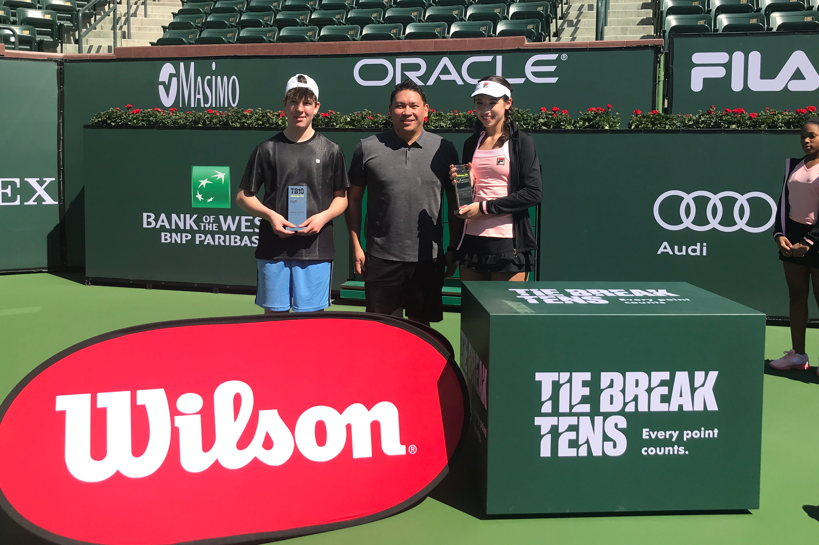 Winners of the Tie Break Tens Challenger arrive at the BNP Paribas Openreceive their trophies, presented by Wilson